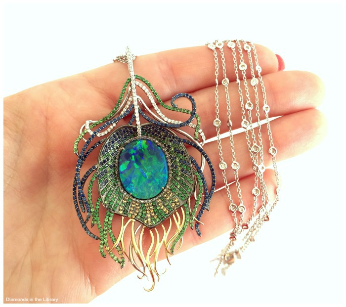 Peacock feather necklace by Robert Pellicca of J.R. Dunn Jewelers. With a 7.78 carat opal, sapphires, tsavorite garnets, yellow sapphires and diamonds.