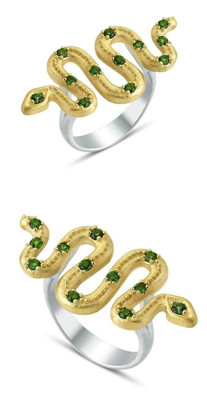 A gold and gemstone snake ring by Stella Flame jewelry.