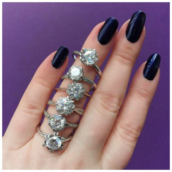 A whole stack of round brilliant cut engagement rings by MaeVona.