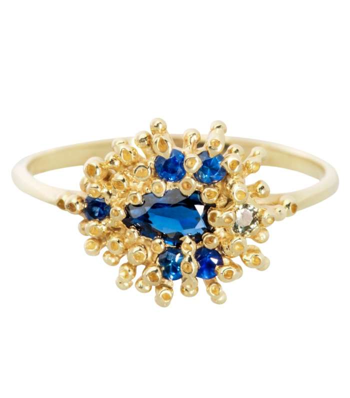 A beautiful handmade ring by Ruta Reifen, with bright blue sapphires in gold.