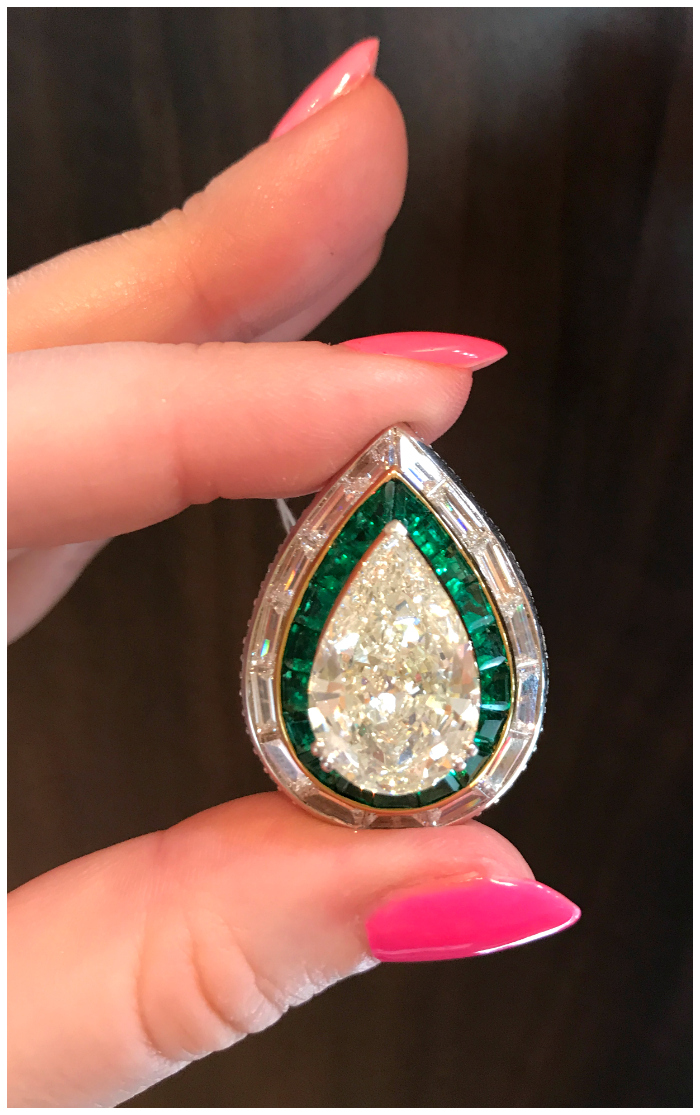 A magnificent diamond ring from Picchiotti! I love these emerald accents.