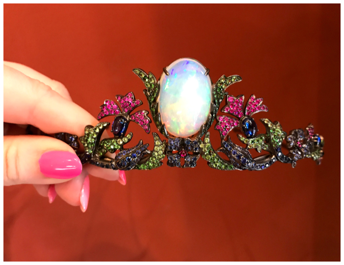 An incredible tiara by French jewelry designer Lydia Courteille. One large, beautiful opal surrounded by plenty of other colored gems.