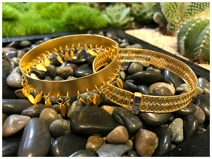 Beautiful gold bracelets by goldsmith and jewelry designer Loren Nicole.