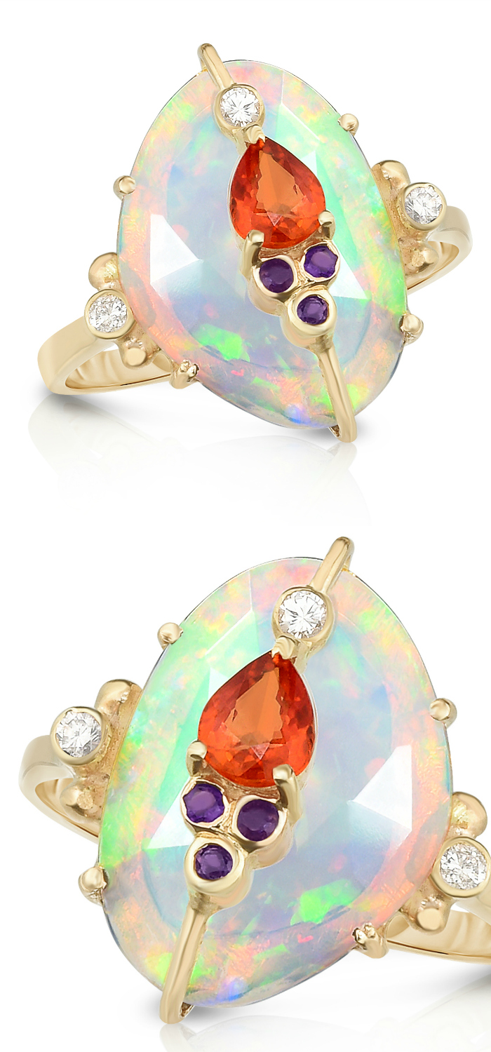 A beautiful opal ring by Loriann Jewelry. With sapphire, amethyst, and diamond accents.