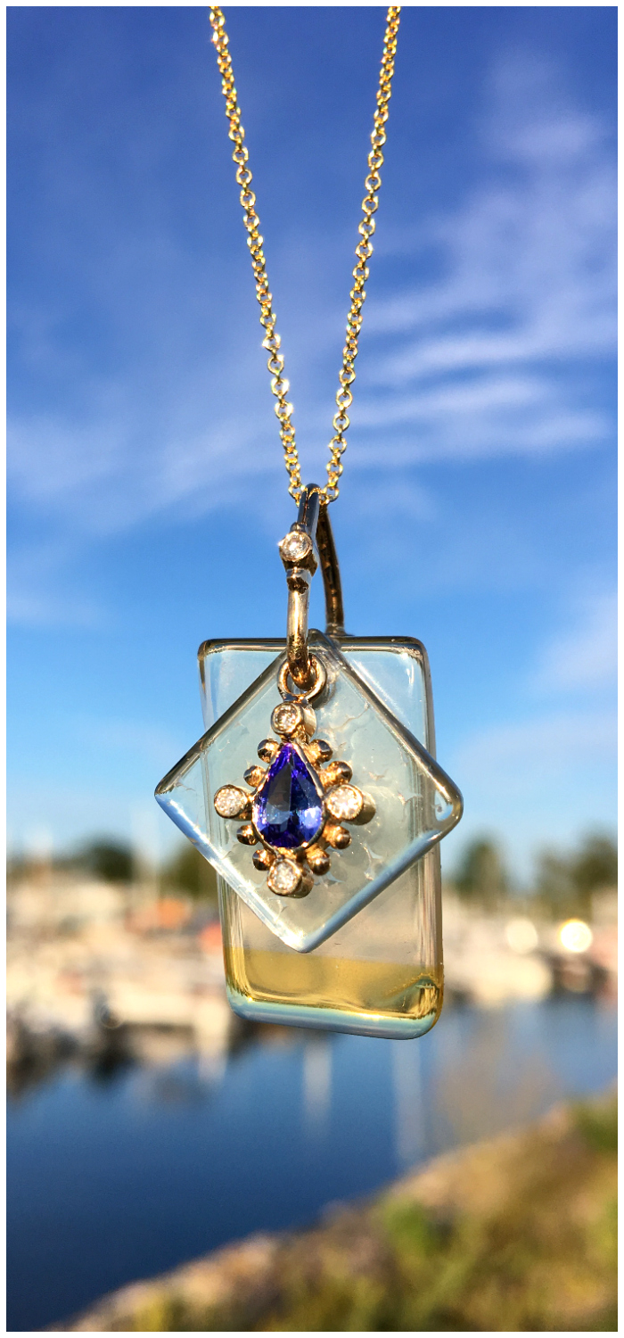The layered gemstone slice effect of this Loriann Jewelry necklace makes it look like wearable stained glass.