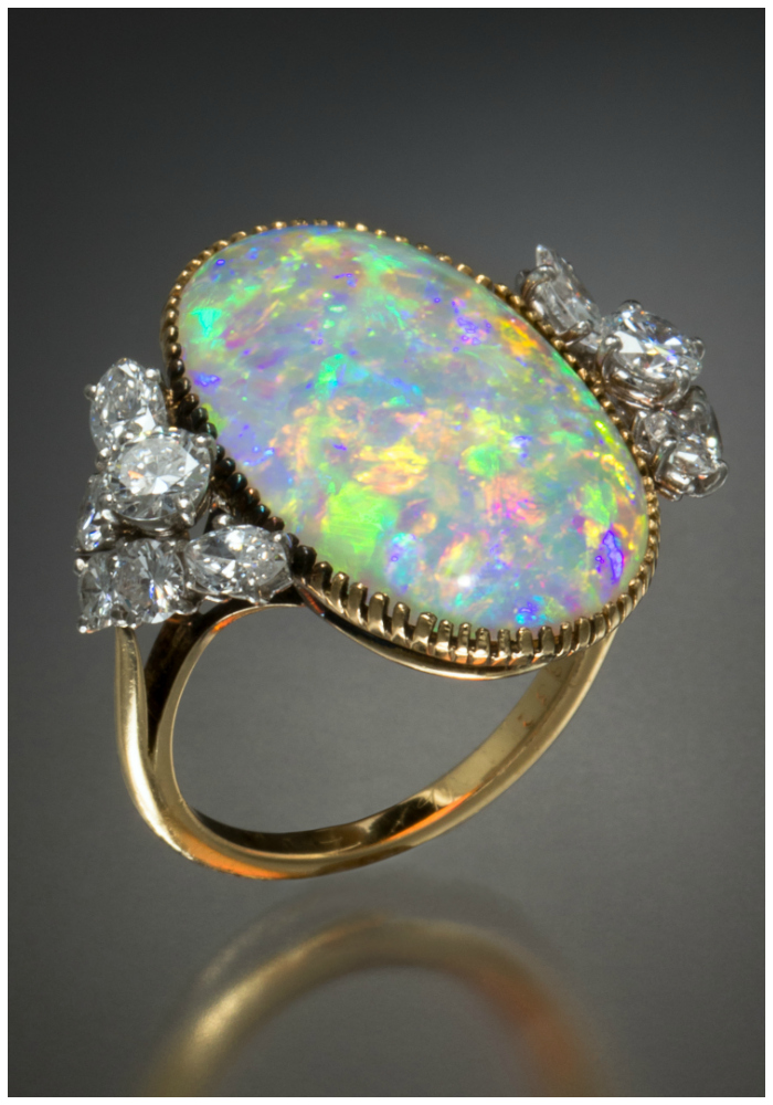A wonderful antique opal and diamond ring by Cartier. So, so so pretty!!!
