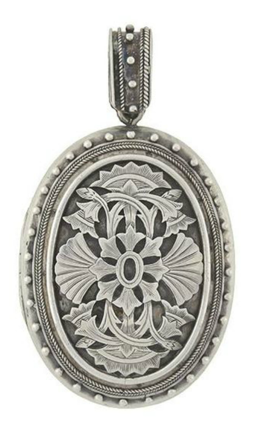 An antique Victorian era sterling silver locket.