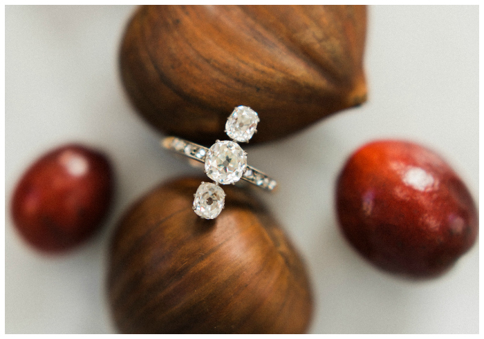 I love this as a vintage engagement ring! It's from the Edwardian era, circa 1905, and features three old mine cushion cut diamonds.