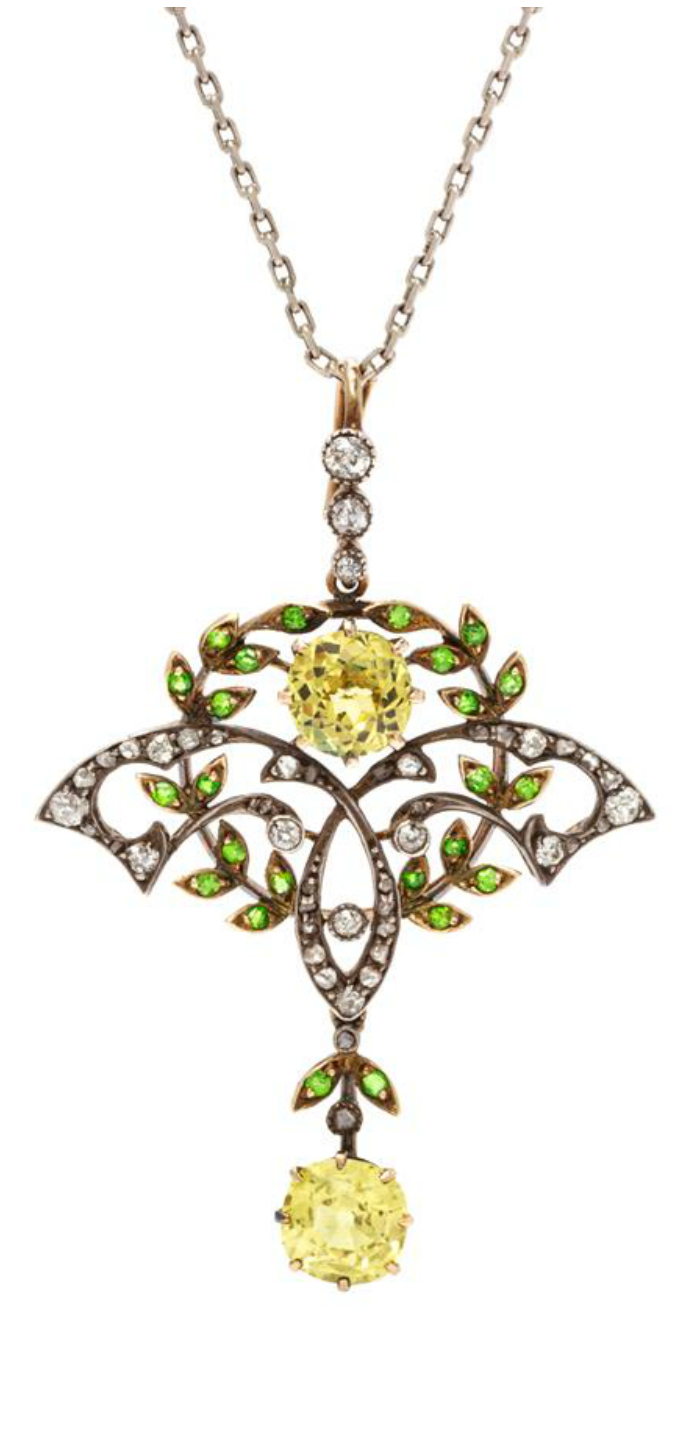 A silver-topped gold, yellow sapphire, demantoid garnet, and diamond pendant necklace by Cooke & Kelvey, Calcutta.