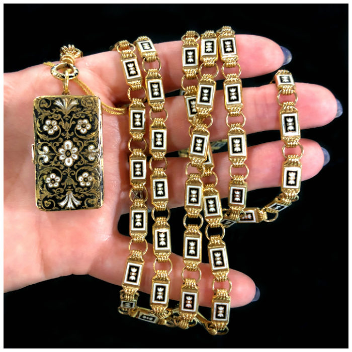 A stunning antique black and white enamel vinaigrette locket on a long gold chain. From DK Bressler.