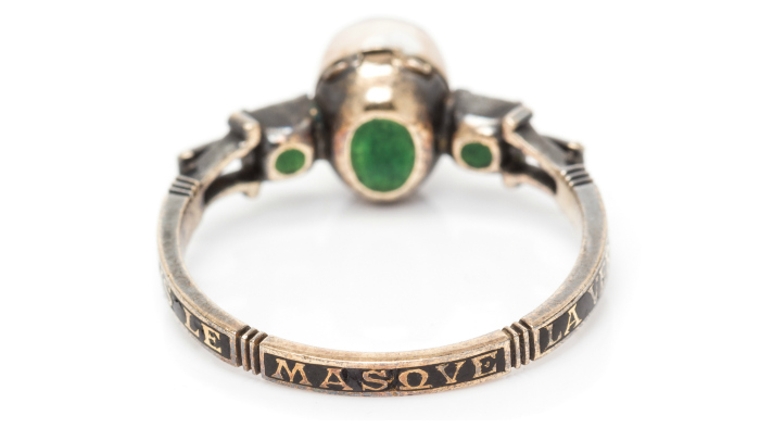 Back view of a rare 18th century Carnival mask ring. This treasure features a secret compartment and reads 'SOVS LE MASQVE LA VERITE' which means 'Under the mask, the truth.'