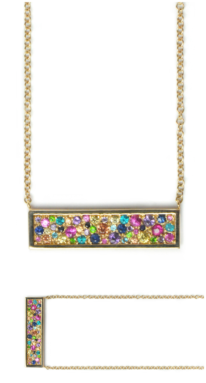 I love this multicolored rainbow bar necklace by Anzie!