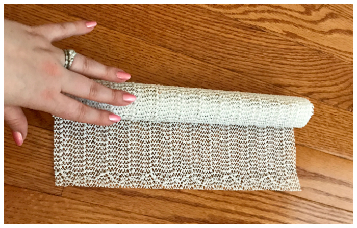 To safely pack necklaces when moving to a new house, try rolling them up in shelf liner!