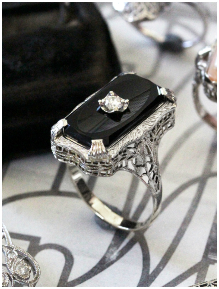 A beautiful vintage ring with filigree detailing, from Market Square Jewelers. Art Deco era.