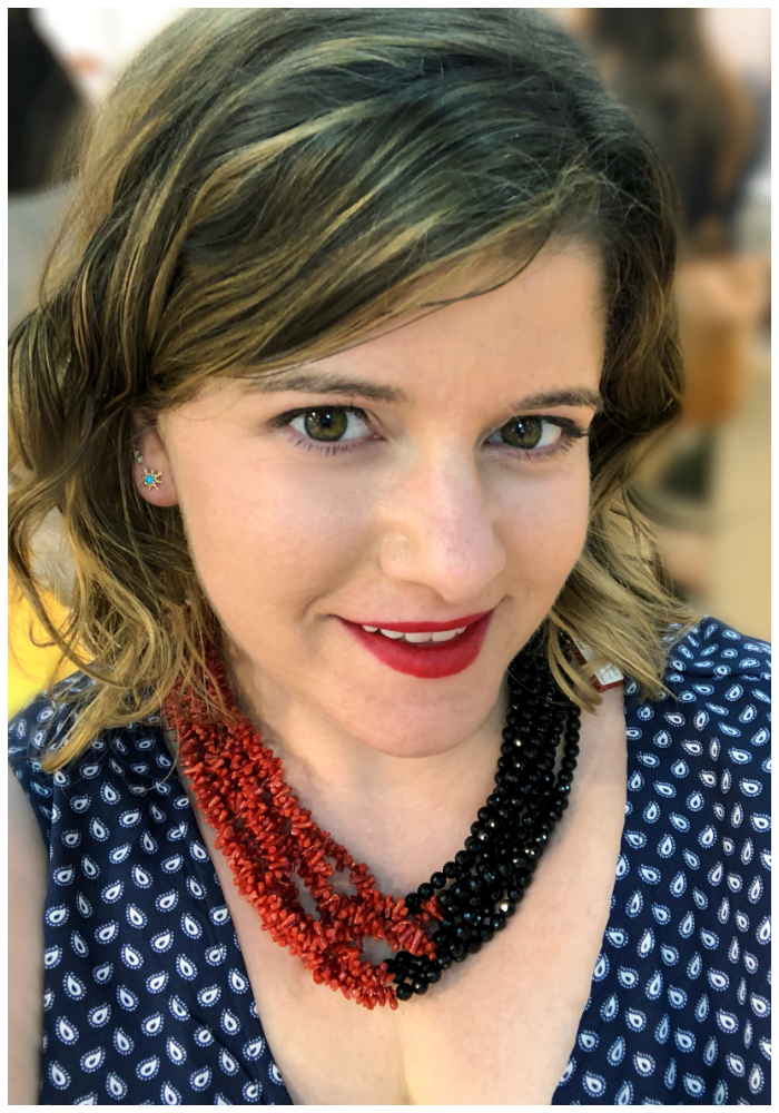 Becky of Diamonds in the Library modeling a glorious coral and hematite necklace by Rajola!