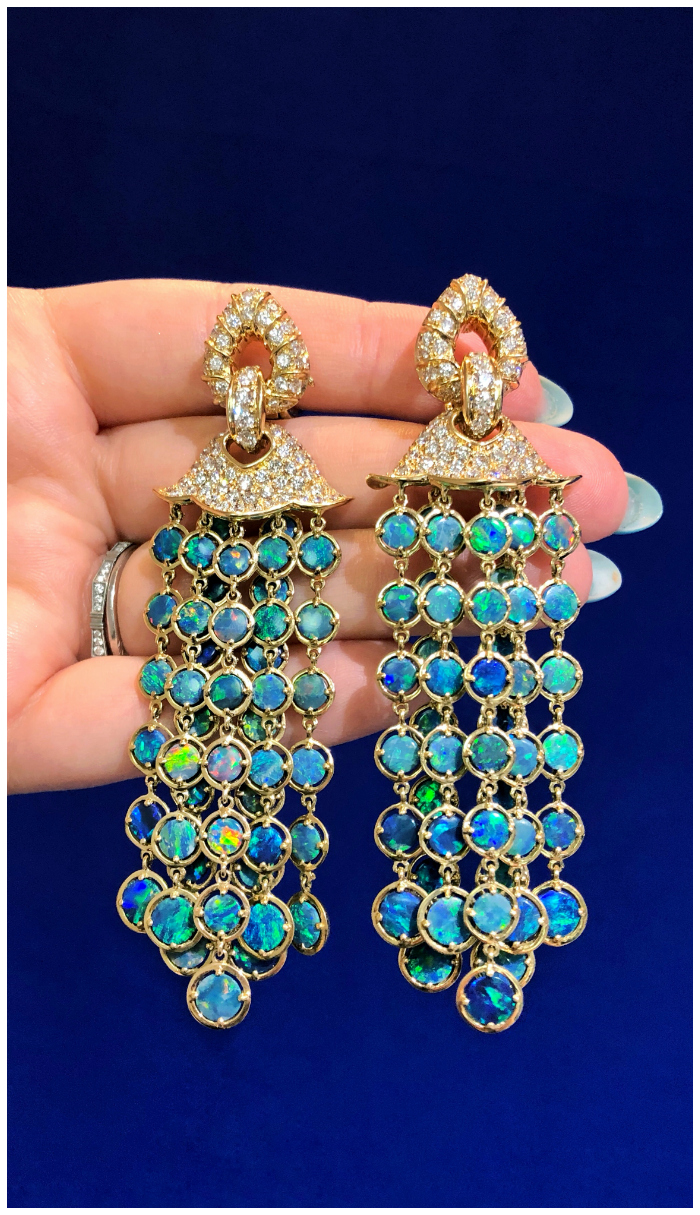 An incredible pair of opal earrings by Marina B! In gold, with diamonds.