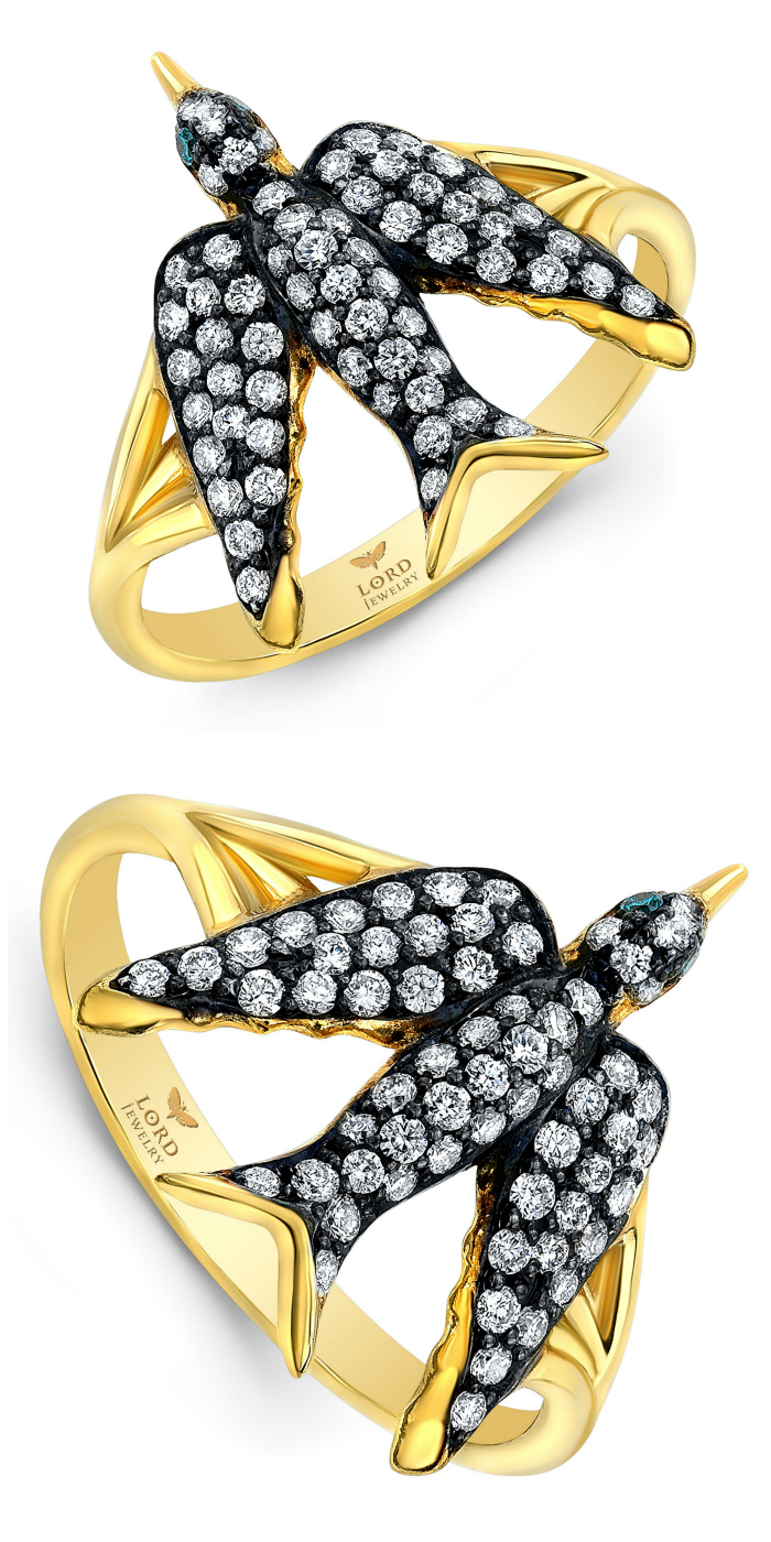 A beautiful bird ring by Lord Jewelry! Diamonds in gold with emerald eyes.