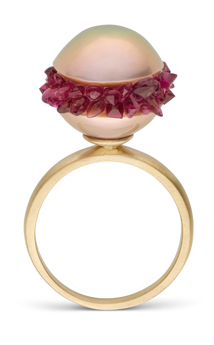 A beautiful pearl ring from the little h Spiral collection. The pearl is set with rubies!