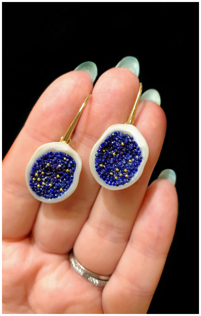 A stunning pair of pearl earrings with lapis and gold! From little h's new collection.