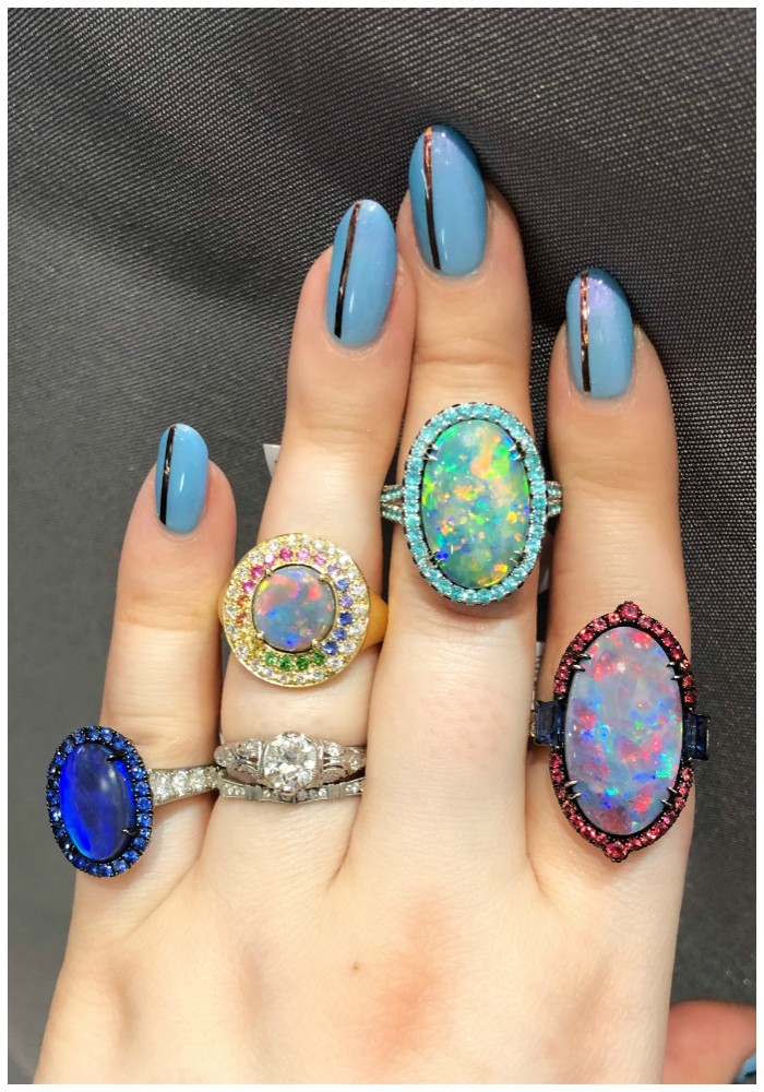 Stunning opal rings by Omi Prive! Set with all different gems, from sapphires to diamonds and Paraiba tourmaline.