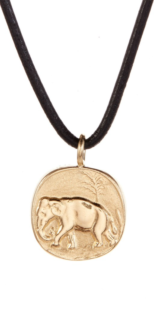 I love this gold elephant pendant necklace by Andrea Gutierrez! Available at The Jewelry Showcase.