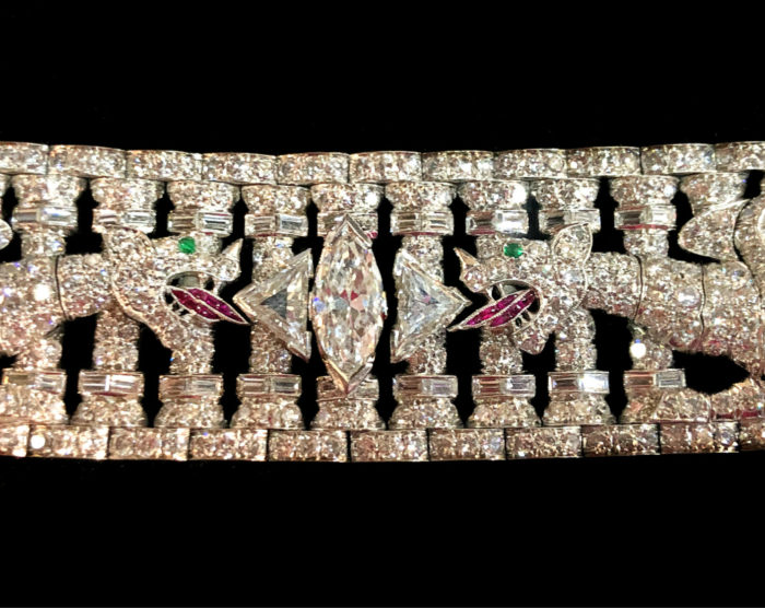 Up close and personal with a stunning Art Deco era bracelet from Pat Saling. Diamonds with ruby tongues and emerald eyes!