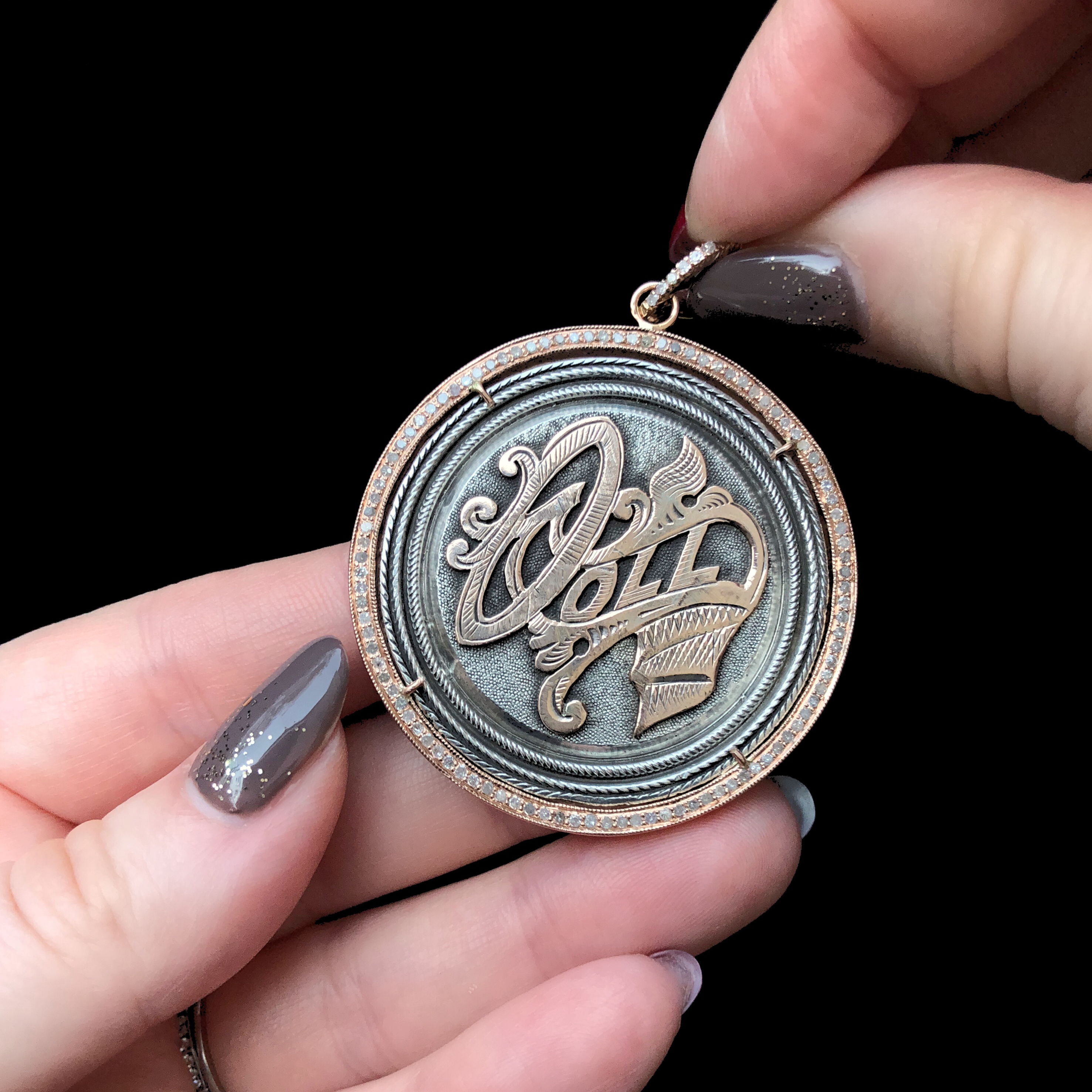 An extraordinary Victorian era love pendant token by Heavenly Vices! This one says 'Doll,' and has rose gold accents.