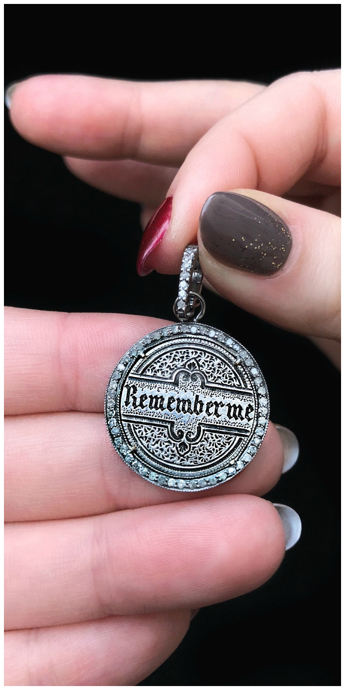 An extraordinary Victorian era love pendant token by Heavenly Vices! This one says 'Remember me' in black enamel.