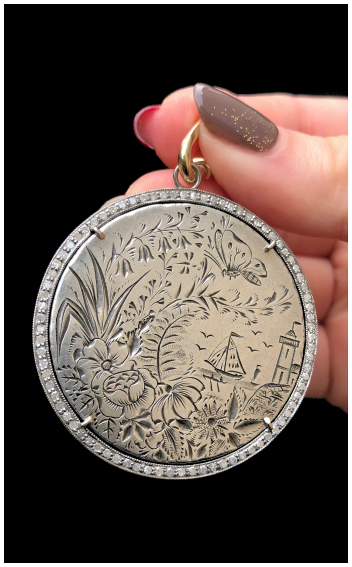 Look at the beautiful scene on this Victorian era love token! It's been set into a pendant by Heavenly Vices.