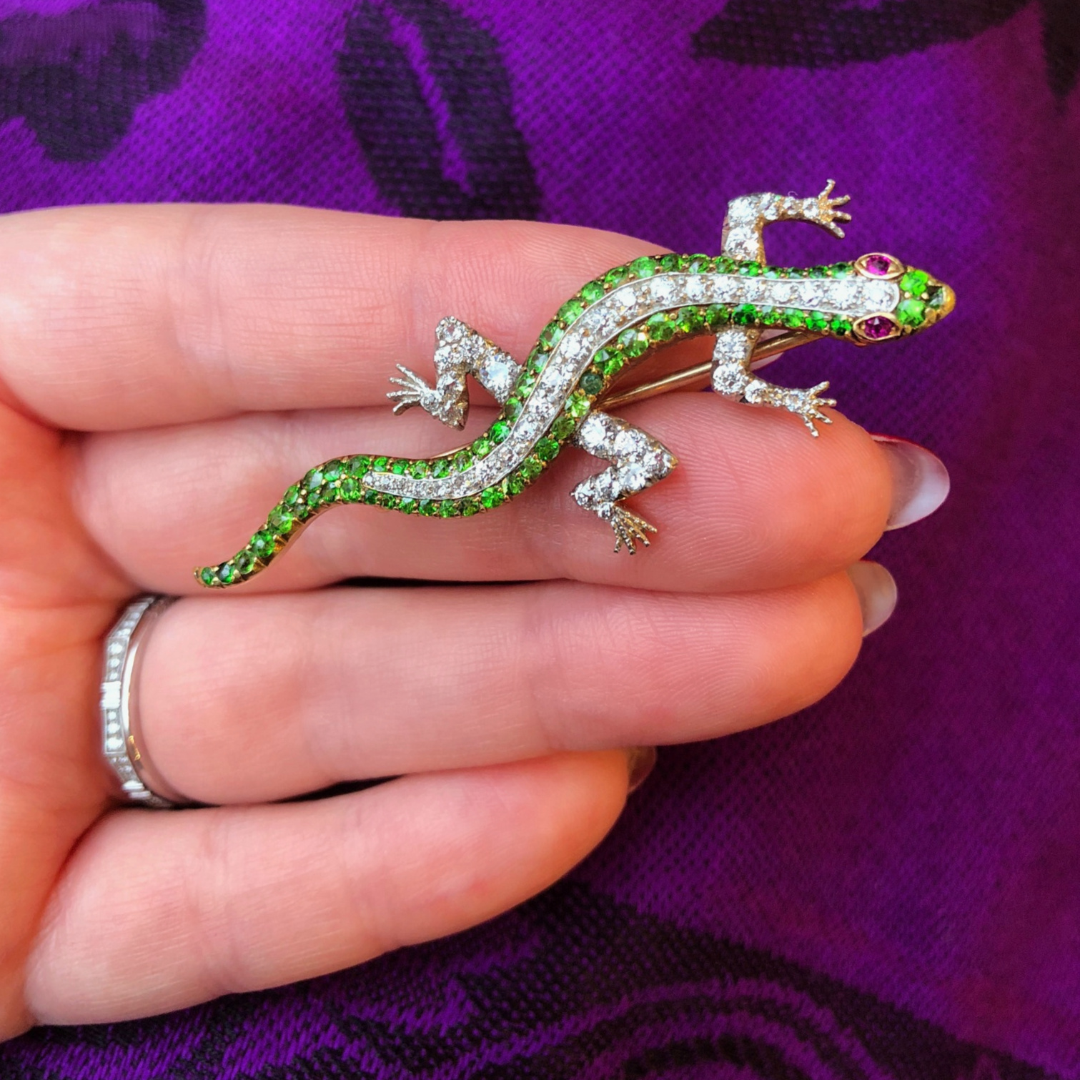 A beautiful antique demantoid garnet and diamond lizard pin from Wilson's Estate Jewelry!