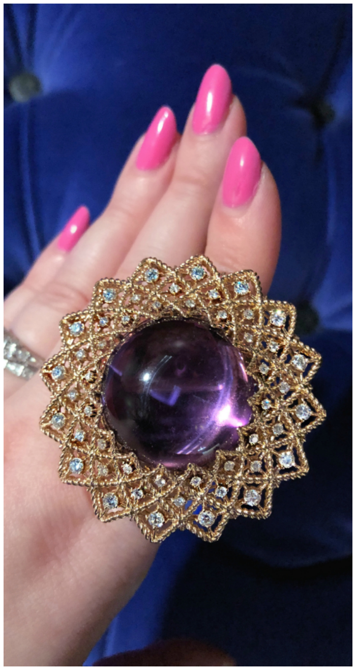 A glorious amethyst cabochon ring from Roberto Coin's new collection! Surrounded by diamonds in gold.