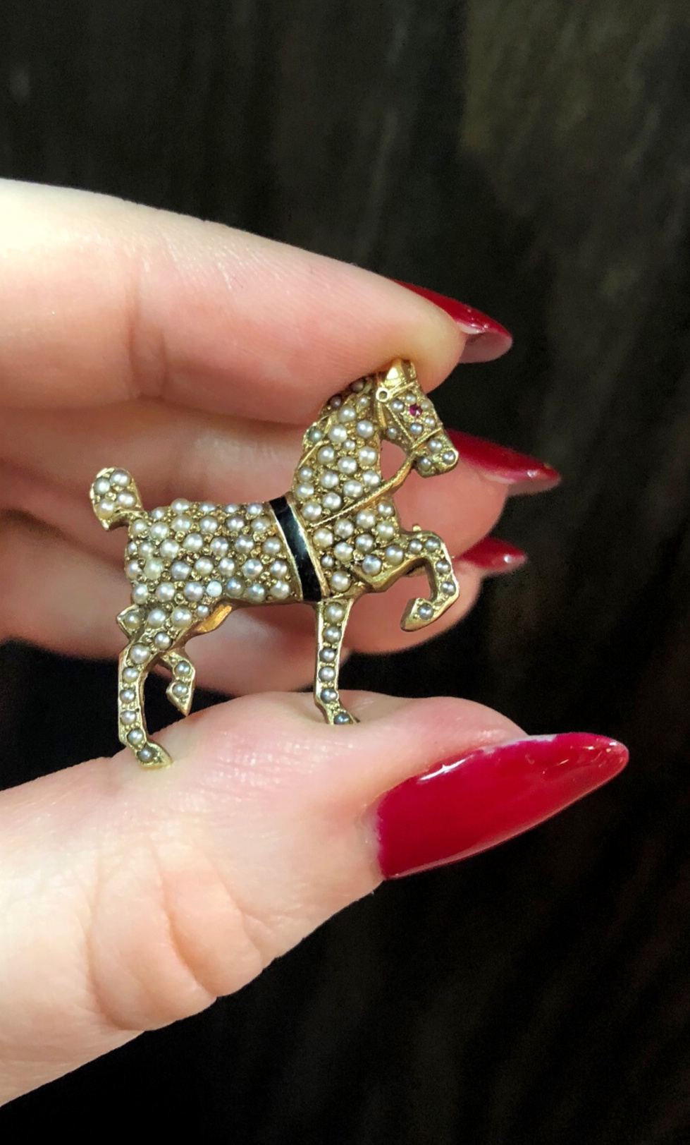 A lovely antique horse brooch with pearls. From Wilson's Estate Jewelry.