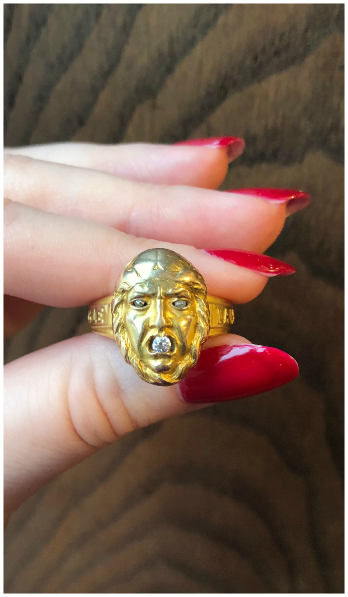 An incredible antique gold ring from Wilson's Estate Jewelry! This ring is a locket; the face flips up to reveal a picture.