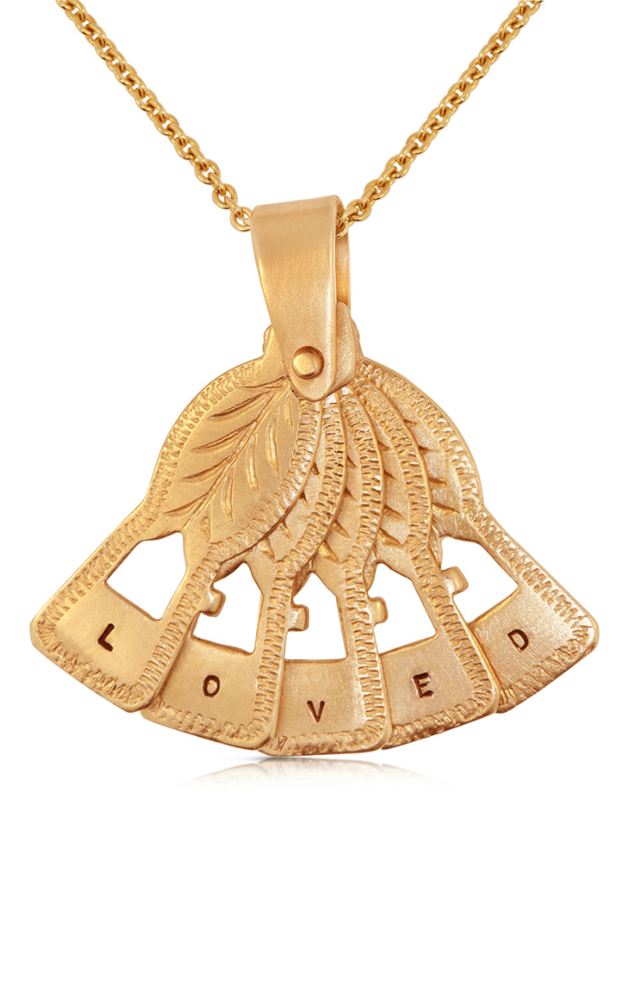 The Lulu and Shay fan pendant. This lovely gold pendant moves like a real fan and has a secret message of love.