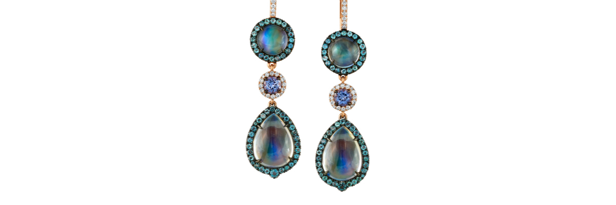 Irresistible iridescent earrings by Omi Prive.