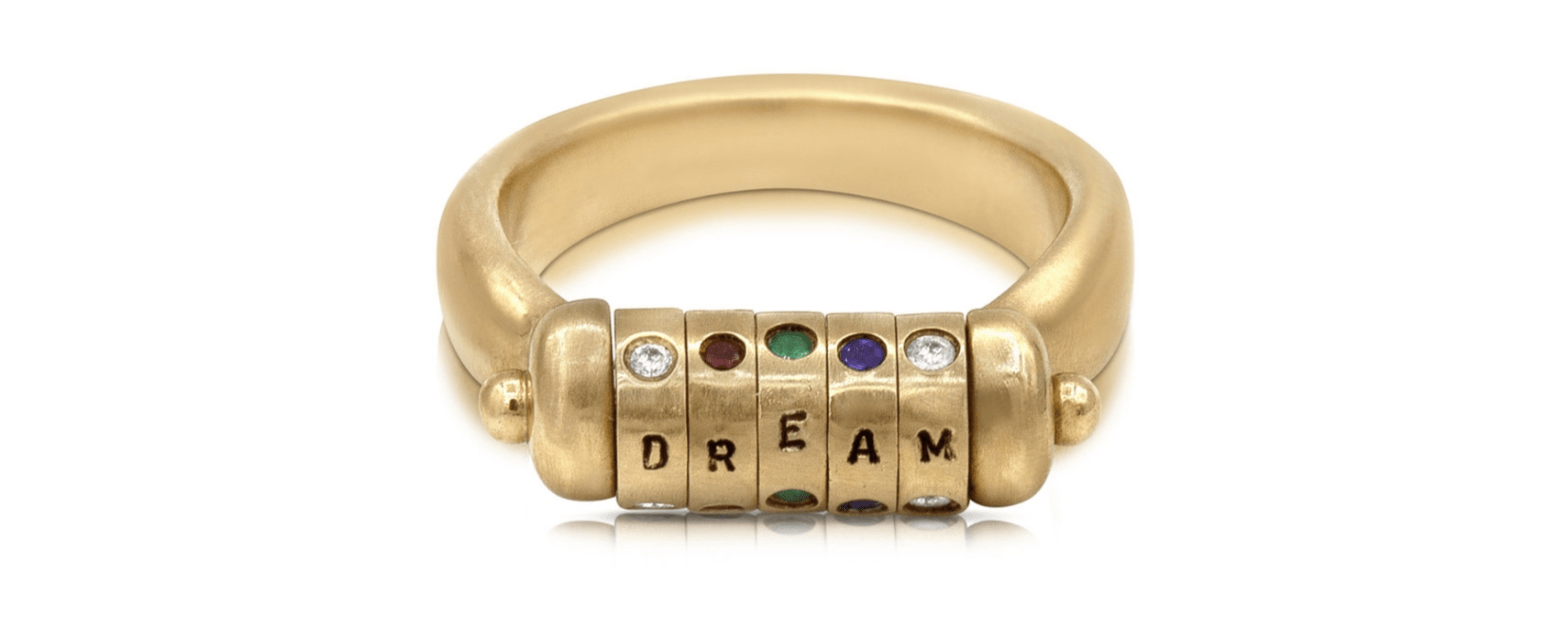 The Dream acrostic ring by Lulu and Shay! Gems in yellow gold spell out a secret message.