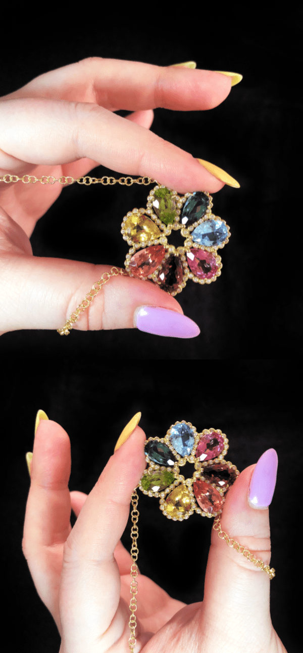 I love this rainbow pendant from Suzy Landa! Gemstones in gold with diamonds.
