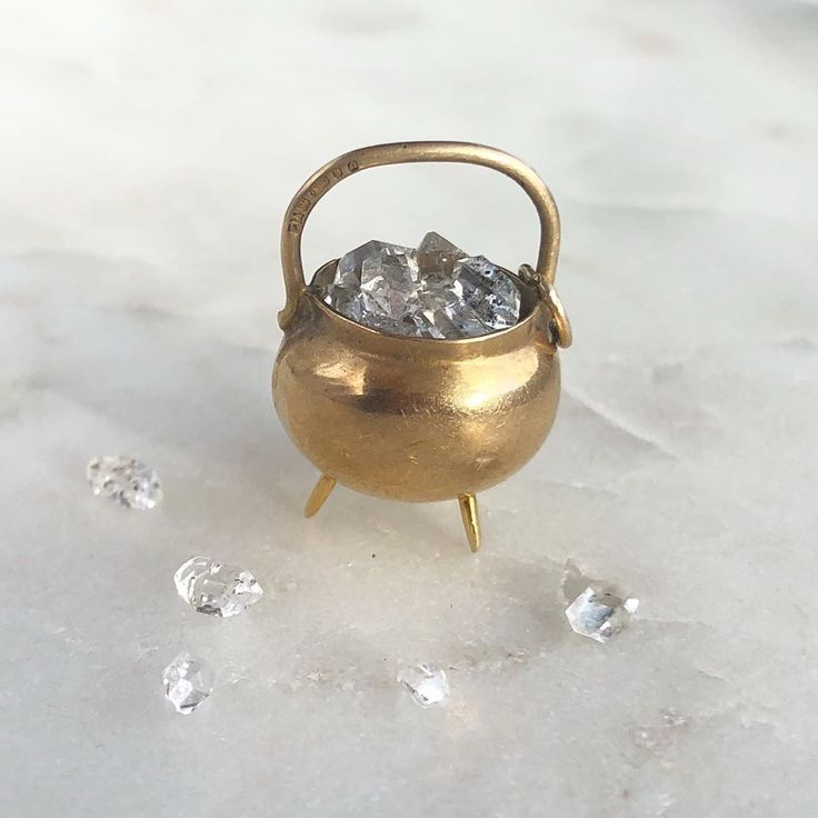 The cutest gold cauldren charm you ever saw. Via Kate Gold Jewelry on Instagram.
