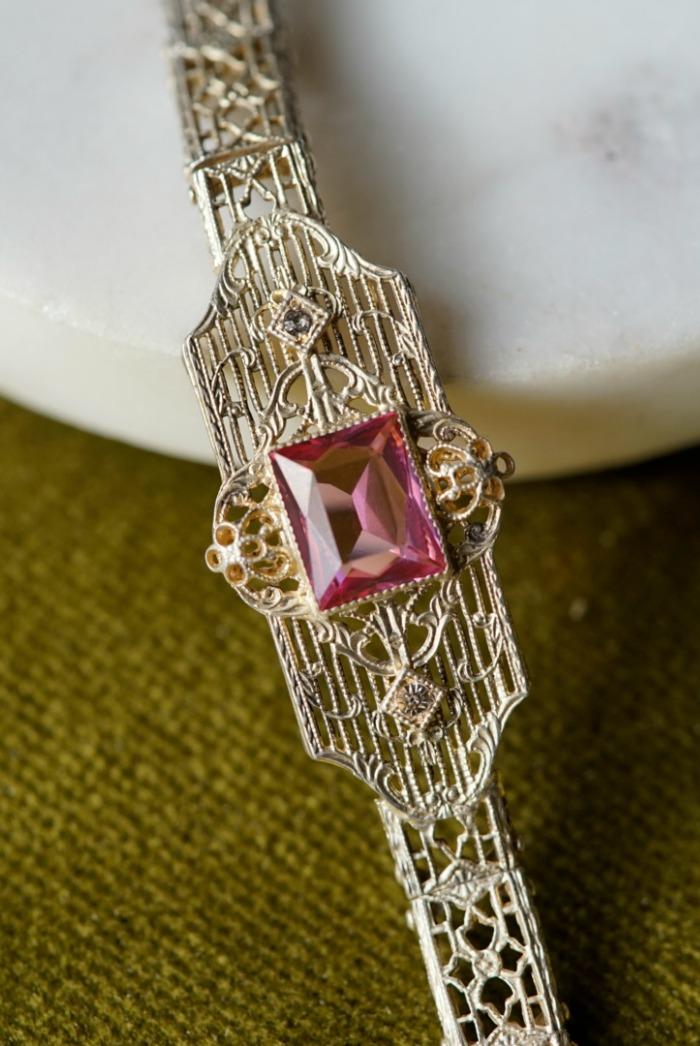 A lovely, lacy, delicate bracelet from the Art Deco era, with a pink stone.