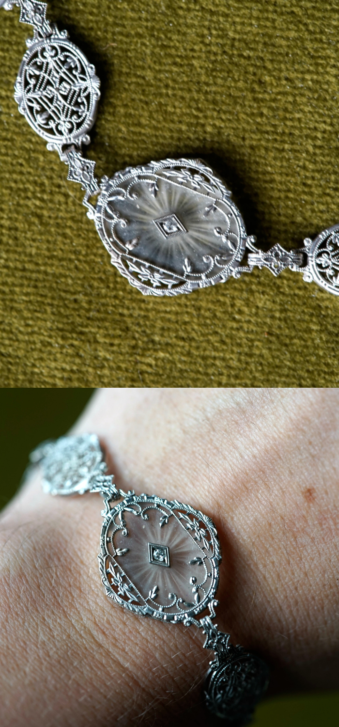 A stunning antique camphor glass bracelet with white gold filigree and diamond details. From the Art Deco era.