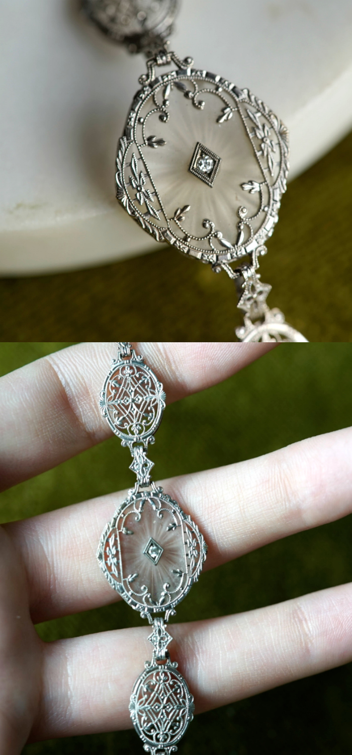 The details on this Art Deco camphor glass bracelet are so exquisite! White gold filigree and diamonds.