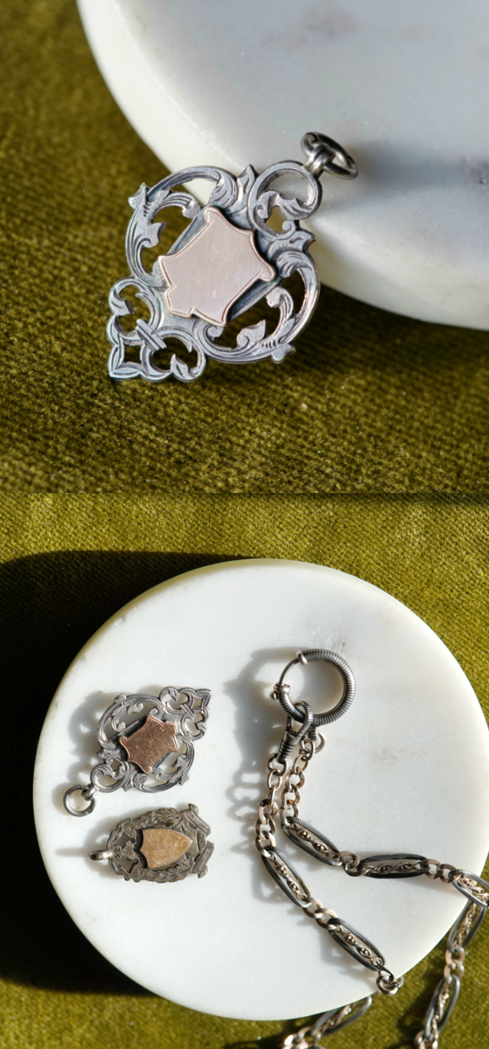 Two antique silver shield fob charms and a Victorian era Niello watch chain. So good together!