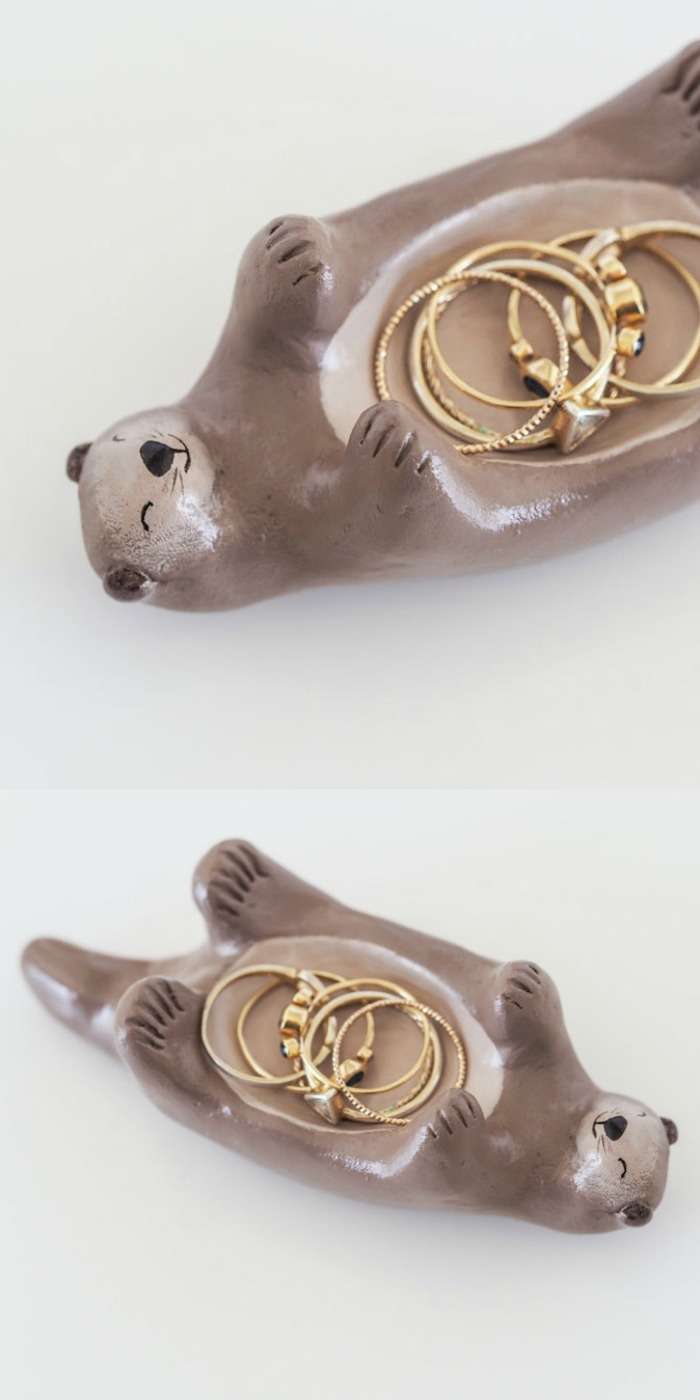 A hand painted otter jewelry holder by Paint My Dream.