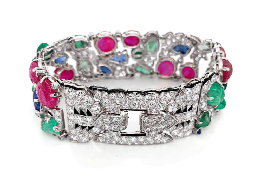 A rare and beautiful Cartier Tutti Frutti bracelet; Art Deco era, circa 1930. Diamonds with carved rubies, emeralds, and sapphires. Back view