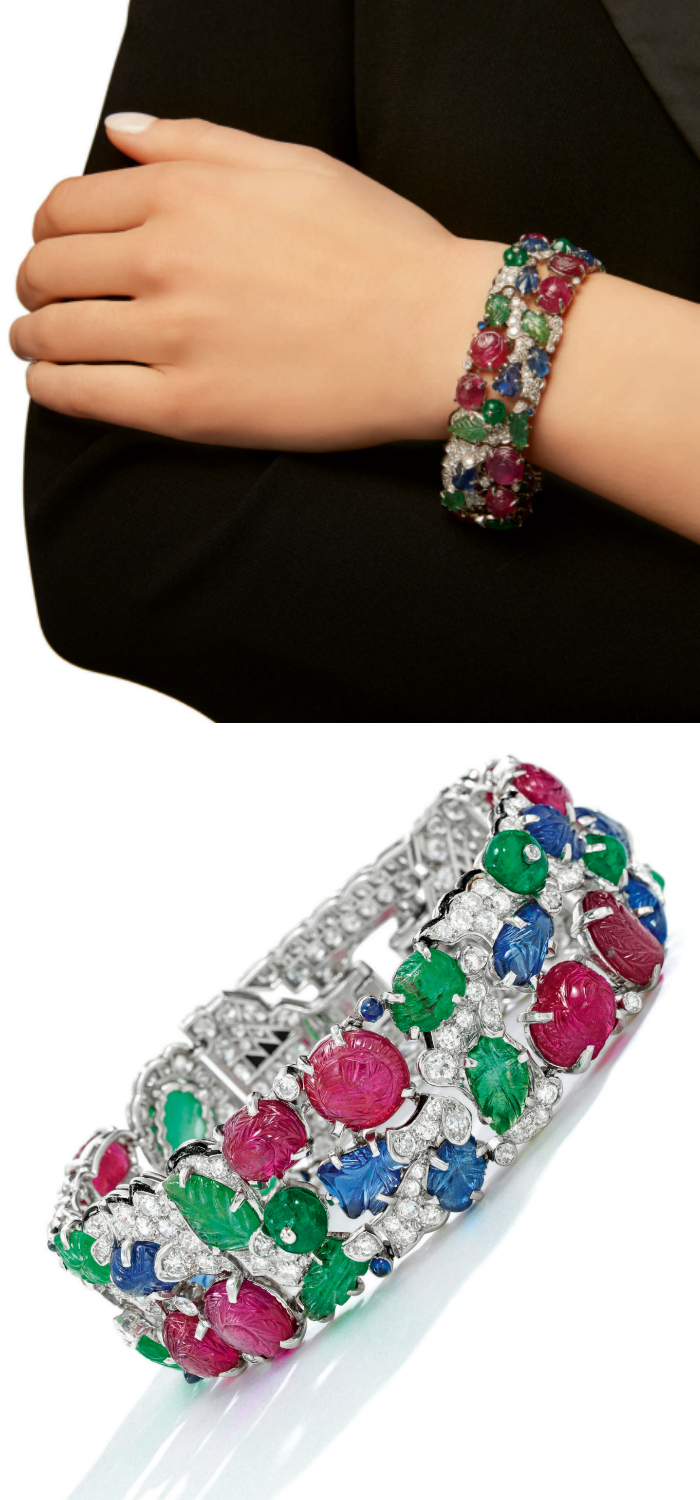 An antique Art Deco Cartier Tutti Frutti bracelet, circa 1930. Diamonds with carved rubies, emeralds, and sapphires. Model view and flat lay.