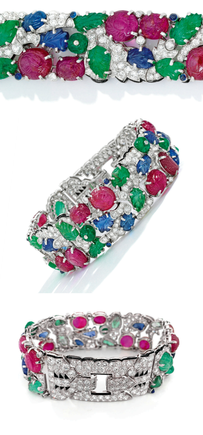 Several views of an Art Deco Cartier Tutti Frutti bracelet, circa 1930. Diamonds with carved rubies, emeralds, and sapphires. Model view and flat lay.