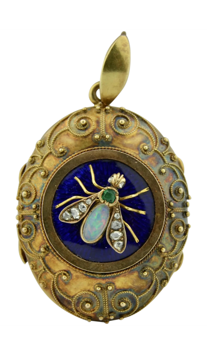 Early Victorian gold locket with blue enamel, Etruscan revival details, and an opal and emerald fly with diamond wings. From Okey's Secret Room on Ruby Lane.