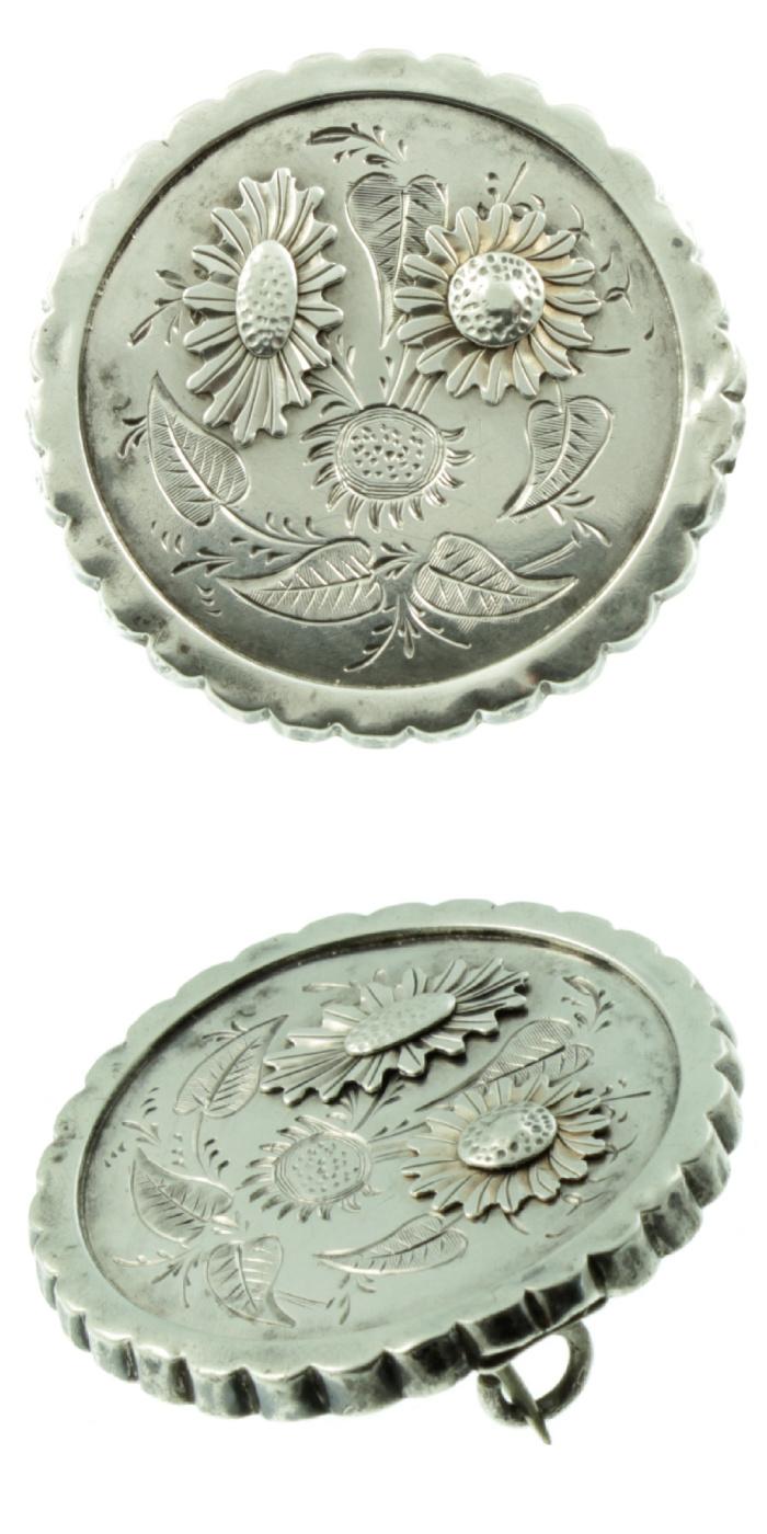 Victorian era daisy brooch in silver. From Carus Jewellery.