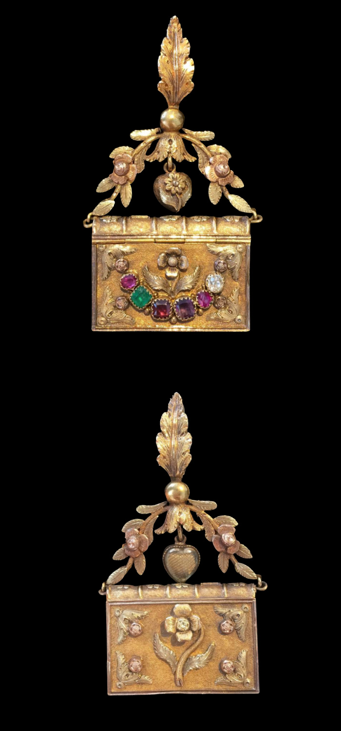 A rare Georgian era acrostic vinaigrette pendant! Shaped like a book with the word REGARD in gems and hair compartment. From Hancock's.