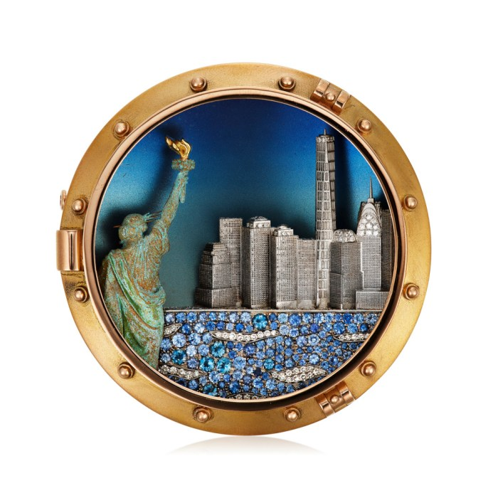 Brooch by Michele della Valle showing the New York City skyline and the Statue of Liberty. In titanium and copper with diamonds, sapphires, and gold.